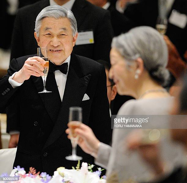 Japanese Emperor Akihito and Empress Michiko toast during a dinner to celebrate the 100th anniversary of the US nonprofit organization Japan Society...