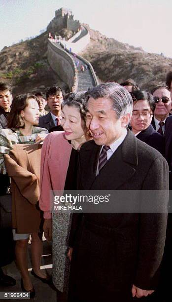 Japanese Emperor Akihito and Empress Michiko tour the Badaling section of the Great Wall northwest of Beijing 24 October 1992 Akihito arrived in...