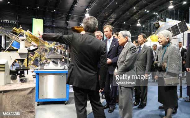 Japanese Emperor Akihito and Empress Michiko visit a facility of the Japan Aerospace Exploration Agency in Tsukuba northeast of Tokyo with...