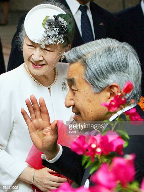 Japanese Emperor Akihito and Empress Michiko wave as they arrive at a hotel in Saipan on June 27 2005 in the Northern Mariana Islands This is the...
