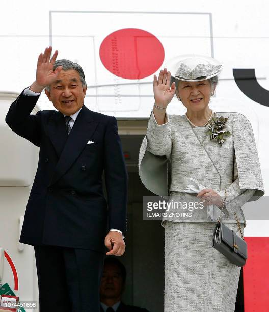 Japanese Emperor Akihito and Empress Michiko wave before their departure from Riga airport at the end of their two dayvisit to Latvia 26 May 2007...