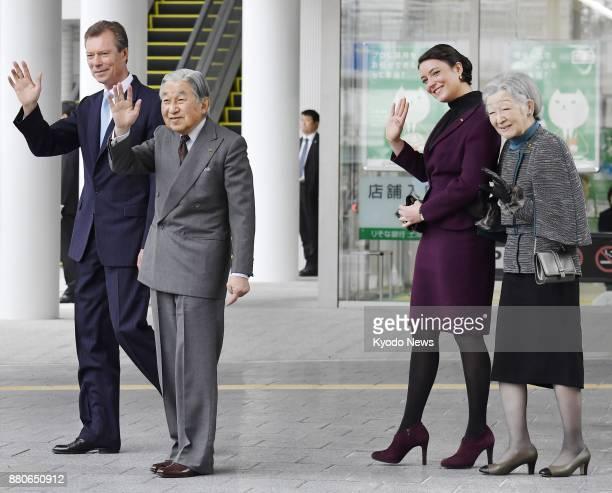 Japanese Emperor Akihito and Empress Michiko wave to people in Tsuchiura Ibaraki Prefecture on Nov 28 2017 along with Luxembourg's Grand Duke Henri...