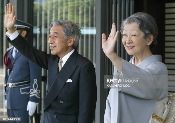 Japanese Emperor Akihito and Empress Michiko wave to send-off guests of visiting African leaders after a tea-ceremony party at the Imperial Palace in...