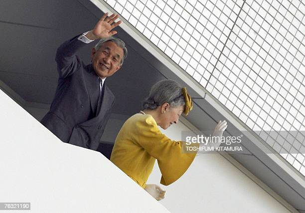 Japanese Emperor Akihito and Empress Michiko wave to the crowd as they attended the 11th IAAF World Athletics Championships in Osaka 25 August 2007...