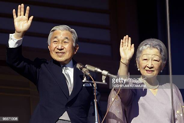Japanese Emperor Akihito and Empress Michiko wave to well wishers as the Imperial family receives new year greetings at the Imperial Palace in Tokyo...