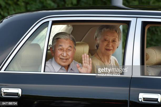 Japanese Emperor Akihito and Empress Michiko wave to wellwishers as they leave the imperial villa in Hayama in Kanagawa prefecture on July 14 2016...