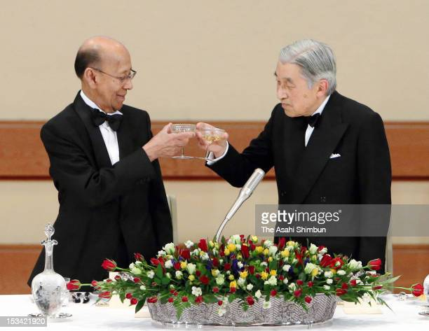 Japanese Emperor Akihito and Malaysian King Abdul Halim Mu'adzam Shah toast during the state dinner at the Imperial Palace on October 3 2012 in Tokyo...