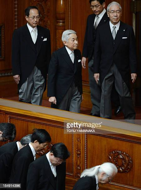 Japanese Emperor Akihito arrives at the upper house to attend the opening ceremony of the Extraordinary Diet session at the National Diet Building in...
