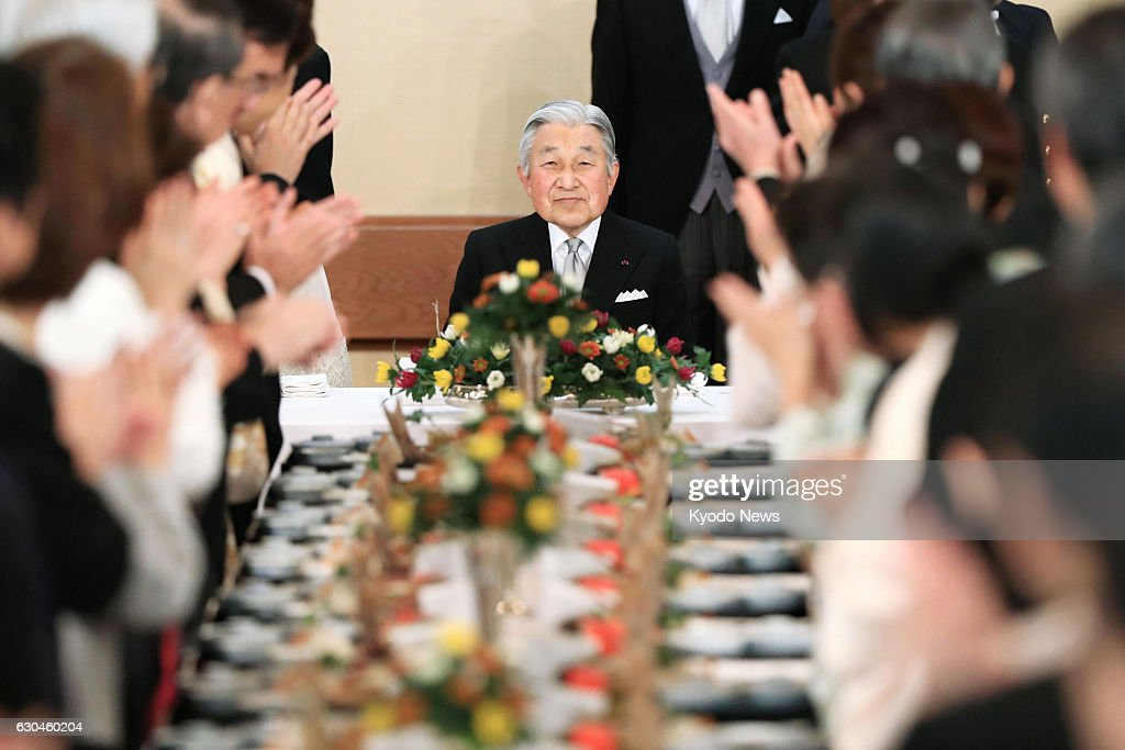 Japanese Emperor Akihito (C) attends a banquet at the Imperial Palace in Tokyo to celebrate his 83rd birthday on Dec. 23, 2016.