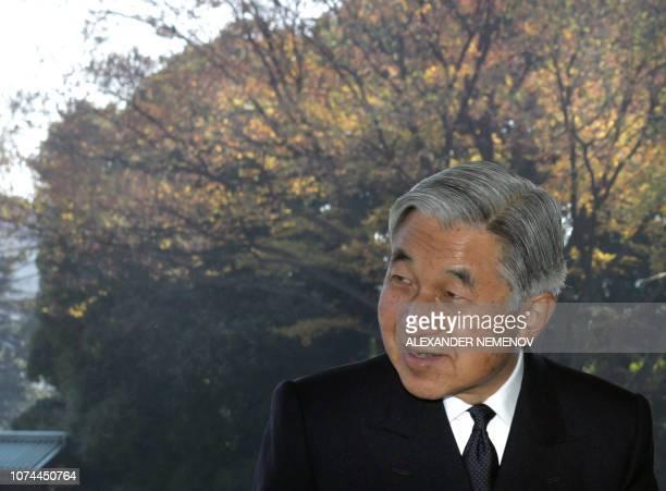 Japanese Emperor Akihito bids farewell to Russian President Vladimir Putin after their meeting at the palace in Tokyo, 22 November 2005. - Putin...