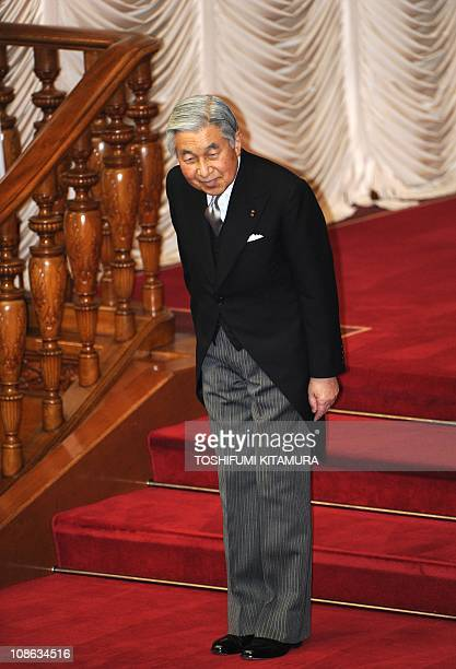 Japanese Emperor Akihito bows after attending the opening ceremony of the Diet session at the upper house of the parliament in Tokyo on January 24...