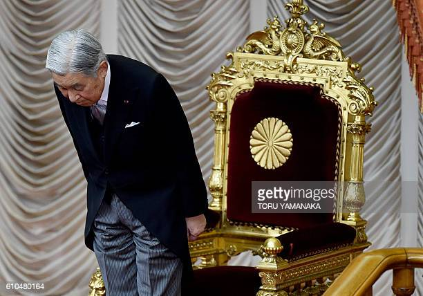 Japanese Emperor Akihito bows before opening an extra Diet session at the upper house of parliament in Tokyo on September 26 2016 Prime Minister Abe...