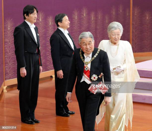Japanese Emperor Akihito Empress Michiko and their sons Prince Akishino and Crown Prince Naruhito attend a New Year's ceremony at the Imperial Palace...