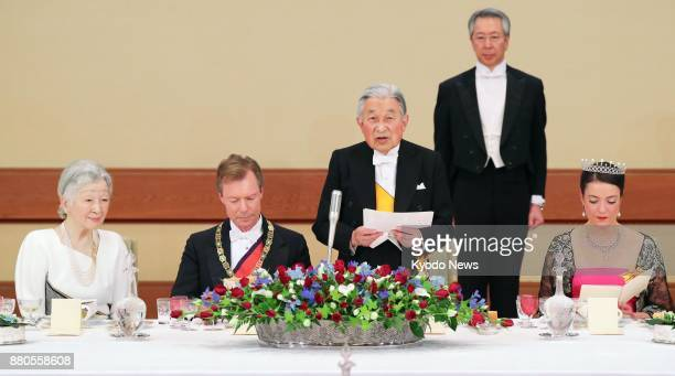 Japanese Emperor Akihito gives a speech during a banquet for Luxembourg's Grand Duke Henri and his eldest daughter Princess Alexandra at the Imperial...