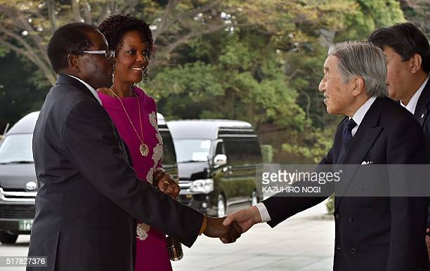 Japanese Emperor Akihito greets Zimbabwean President Robert Mugabe and his spouse Grace Mugabe upon their arrival at the Imperial palace in Tokyo on...