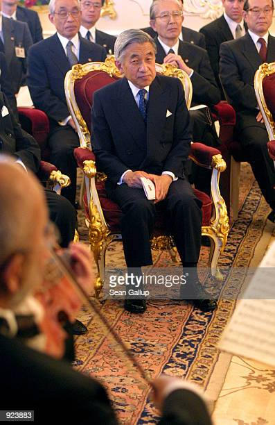 Japanese Emperor Akihito listens to a string quartet at Prague Castle July 8 2002 in Prague Czech Republic The emperor and Empress Michiko are on a...