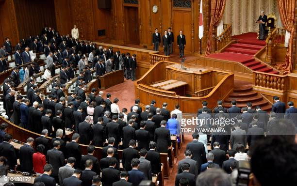Japanese Emperor Akihito makes a speech to open an extra Diet session at the upper house of parliament in Tokyo on September 26 2016 Prime Minister...