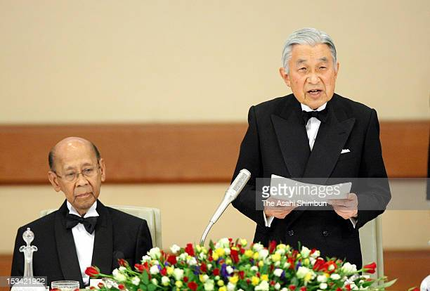 Japanese Emperor Akihito makes a speech while Malaysian King Abdul Halim Mu'adzam Shah listens during the state dinner at the Imperial Palace on...
