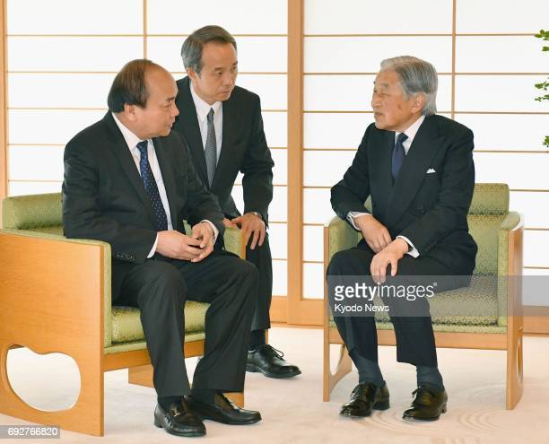 Japanese Emperor Akihito meets with Vietnamese Prime Minister Nguyen Xuan Phuc at the Imperial Palace in Tokyo on June 6 2017 The Vietnamese leader...
