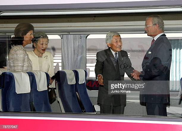 Japanese Emperor Akihito offers a seat to the Swedish King Carl XVI Gustaf on the train accompanied by Japanese Empress Michiko and Swedish Queen...