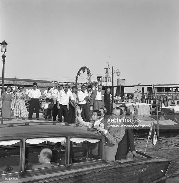 Japanese Emperor Akihito portrayed on a water taxi leaving from the dock Venice 1953