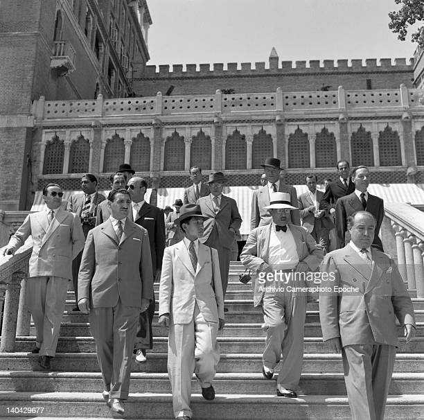 Japanese Emperor Akihito portrayed while descending the Excelsior Hotel stairs Lido Venice 1953