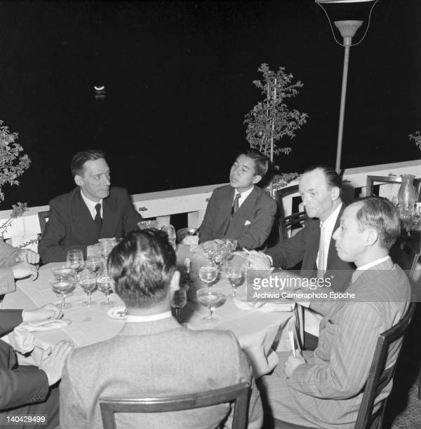 Japanese Emperor Akihito portrayed while sitting at a restaurant table Venice 1953