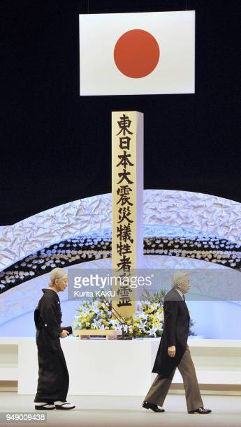 Japanese Emperor Akihito right and Empress Michiko walk by the altar during the national memorial service for the victims of the March 11 earthquake...