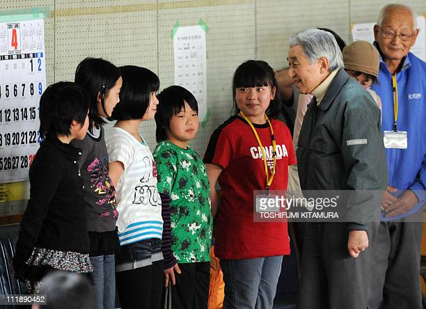 Japanese Emperor Akihito speaks with evacuees from Futaba in Fukushima prefecture at their makeshift shelter in Kazo Saitama prefecture on April 8...