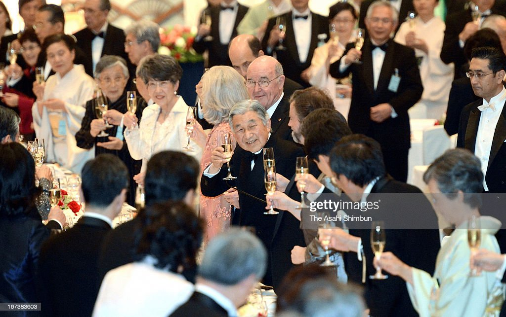 Japanese Emperor Akihito toasts glass during the Japan Prize award ceremony party on April 24, 2013 in Tokyo, Japan.