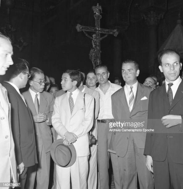Japanese Emperor Akihito visiting a church Venice 1953