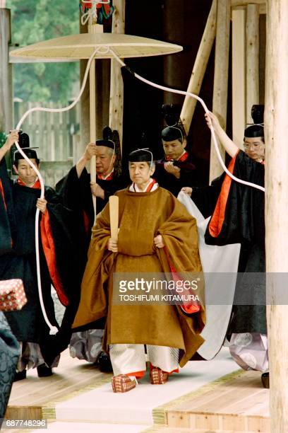 Japanese Emperor Akihito walks towards a carriage after he reported his enthronement to the diety of the outer shrine at Ise on November 27 1990...