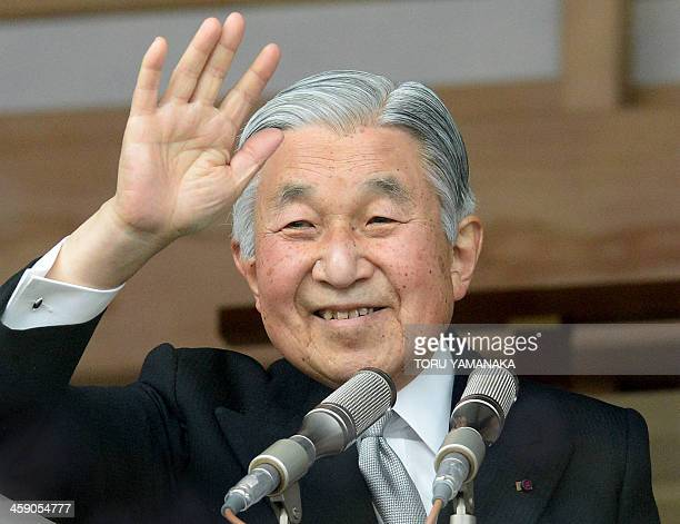 Japanese Emperor Akihito waves to wellwishers celebrating his birthday at the Imperial Palace in Tokyo on December 23 2013 The emperor turned 80...
