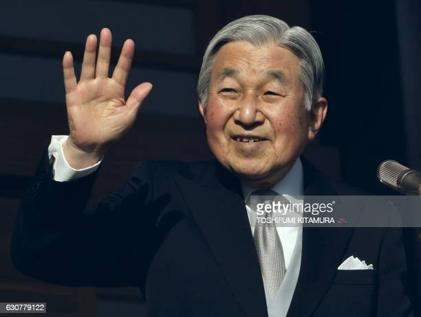 Japanese Emperor Akihito waves to wellwishers during his new year speech beside Empress Michiko on the balcony of the Imperial Palace in Tokyo on...
