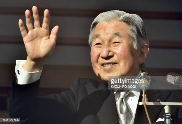 Japanese Emperor Akihito waves to wellwishers gathered for the annual New Year's greetings at the Imperial Palace in Tokyo on January 2 2016 Akihito...