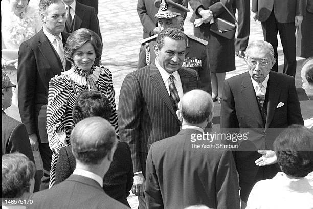 Japanese Emperor Hirohito , Egyptian President Hosni Mubarak and his wife Suzanne attend the welcome ceremony at the state guest house on April 6,...