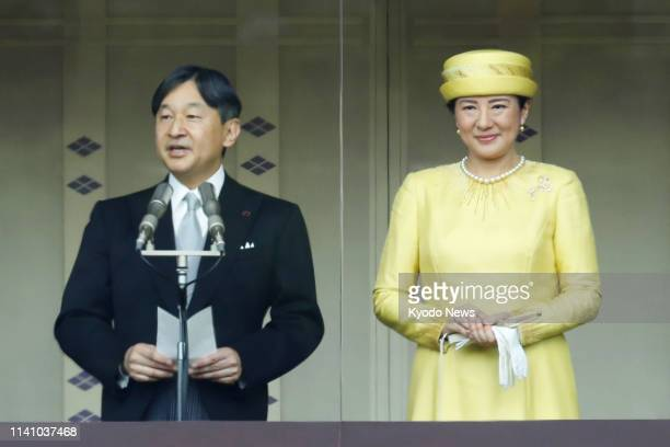 Japanese Emperor Naruhito alongside Empress Masako delivers a speech to thousands of wellwishers gathered at the Imperial Palace in Tokyo on May 4 in...