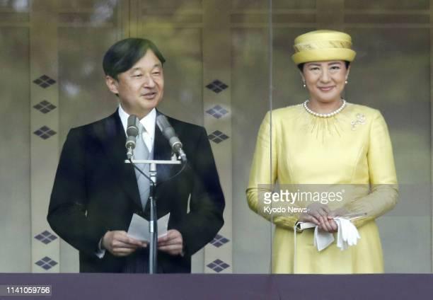 Japanese Emperor Naruhito alongside Empress Masako delivers a speech to wellwishers gathered at the Imperial Palace in Tokyo on May 4 in his first...