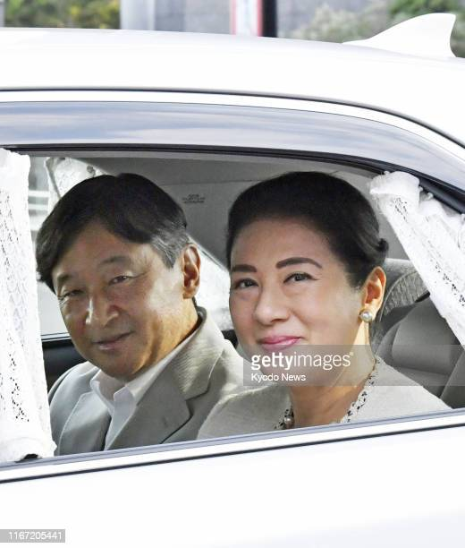 Japanese Emperor Naruhito and Empress Masako arrive at the Imperial Palace in Tokyo on Sept. 10 to see former Empress Michiko, who underwent...