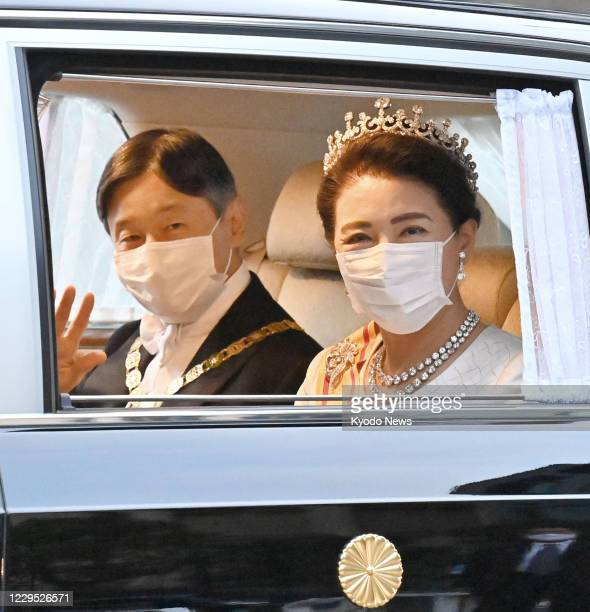 Japanese Emperor Naruhito and Empress Masako arrive at the Imperial Palace in Tokyo on Nov. 8 to attend a ceremony following the formal declaration...