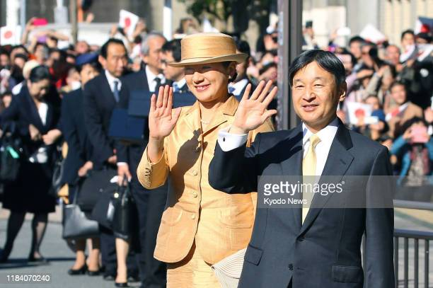 Japanese Emperor Naruhito and Empress Masako wave after finishing their visit to Ise Jingu shrine in Mie Prefecture, central Japan, on Nov. 23 for a...