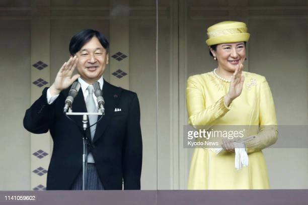 Japanese Emperor Naruhito and Empress Masako wave to thousands of wellwishers gathered at the Imperial Palace in Tokyo on May 4 in his first public...