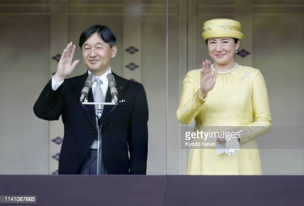 Japanese Emperor Naruhito and Empress Masako wave to wellwishers gathered at the Imperial Palace in Tokyo on May 4 in his first public appearance...