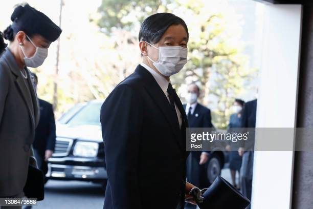 Japanese Emperor Naruhito and Empress Masako wearing face masks arrive at the National Theatre of Japan to attend the national memorial service for...