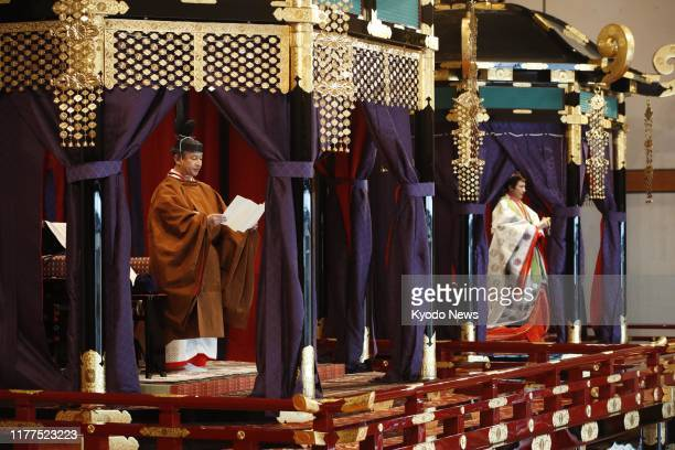 Japanese Emperor Naruhito delivers a speech to proclaim his enthronement from the Takamikura imperial throne in the Matsu no Ma state room of the...