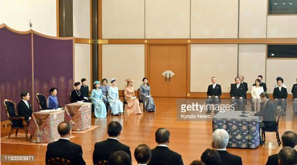 Japanese Emperor Naruhito , Empress Masako and other imperial family members listen to a scholar's New Year lecture at the Imperial Palace in Tokyo...
