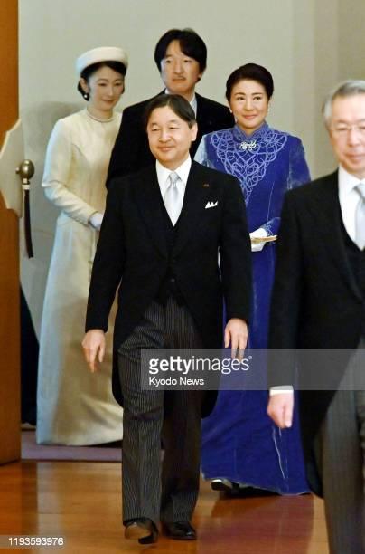Japanese Emperor Naruhito , Empress Masako , Crown Prince Fumihito and Crown Princess Kiko prepare to sit down for New Year lectures by scholars at...