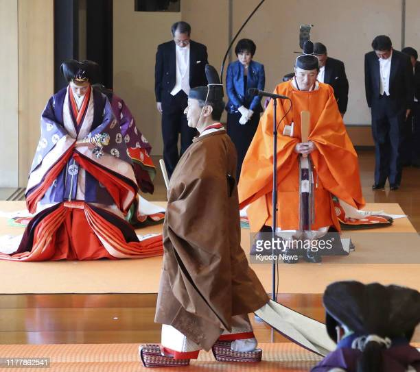 Japanese Emperor Naruhito leaves a room at the Imperial Palace in Tokyo on Oct 22 after proclaiming his enthronement Crown Prince Fumihito and his...
