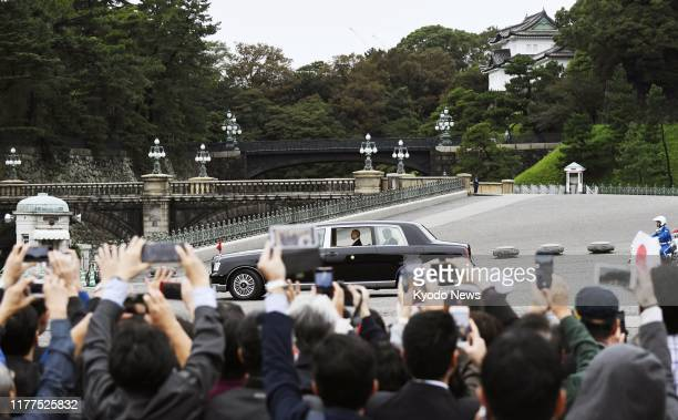 Japanese Emperor Naruhito leaves the Imperial Palace in Tokyo by car after proclaiming his enthronement before roughly 2000 guests from Japan and...