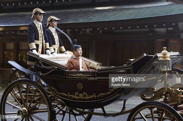 Japanese Emperor Naruhito rides in a horse-drawn carriage on his way to perform a ceremony marking the completion of two major rites signifying his...